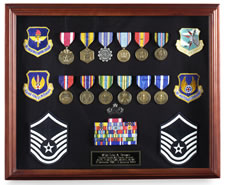 With free shipping!  Big, bold, and classy! Hand-made in the USA with solid American cherry with cherry finish. Includes both blue and black felt backgrounds for easy medal display. Crystal clear classy glass face and an easy-to-use hinged lid design! Click image to enlarge.