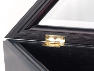 Closeup view the detailed craftsmanship of the Military Officer's Memorial Flag Case with solid brass hinges and fine Black Cherry Finish for large American flags